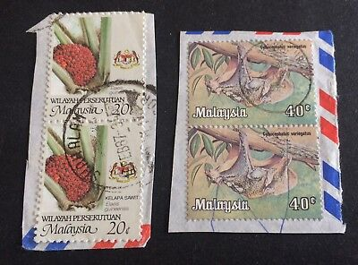 4 nice old used stamps on paper Malaysia