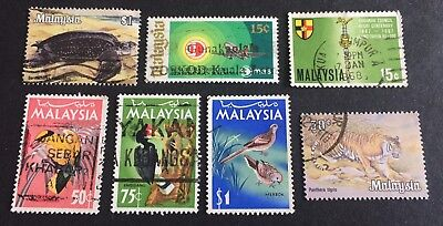 7 nice old used stamps Malaysia