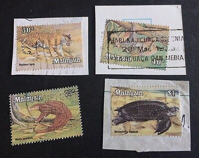 4 nice old used stamps animals Malaysia