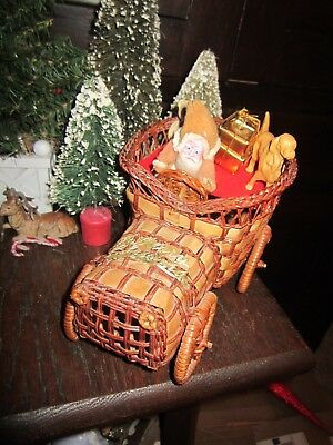 Vintage Japan Santa Riding a Woven Basket Car