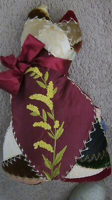 Large crazy quilt cat made from an antique crazy quilt