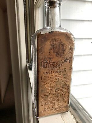 Labeled Fruitcura Womans Tonic Cure Bottle