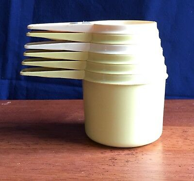 Vintage Tupperware 6 Piece Measure Cup Set Yellow and Beige