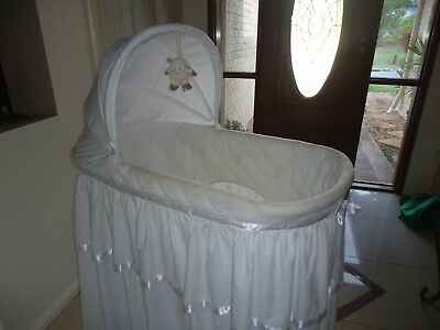White Baby Bassinet. This item is used. Includes additional bedding.