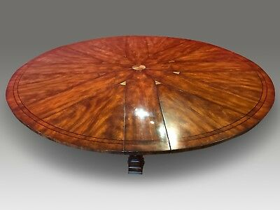 5 ft to 7.11 Stunning Sunburst Flame mahogany Jupe circular Grand dining table.