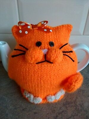 Hand-knitted Jemima the ginger cat tea cosy. Fits medium teapot