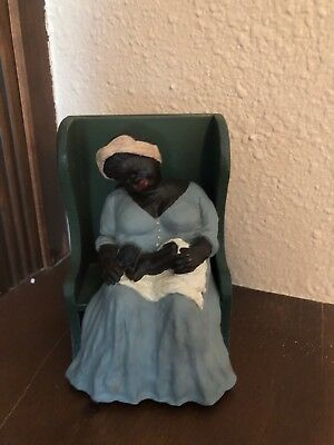 African American Woman Holding a Toddler Figurine