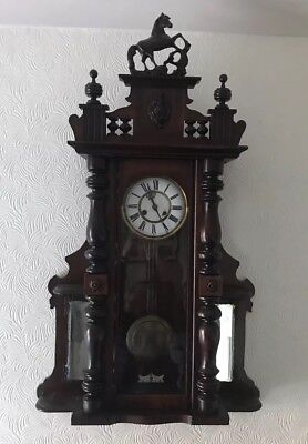 Circa 1900 Mahogany Wall Clock With Pendulum, Horse Detail & side mirrors