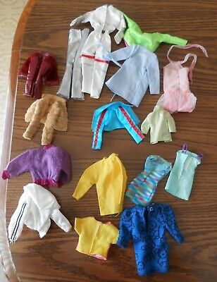 Lot of 33 pieces of genuine Barbie clothes with tags; includes astronaut suit