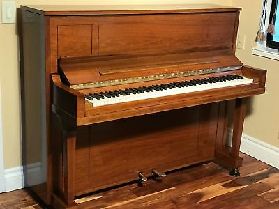 Steinway & Sons Upright Model 45 in great condition sound like baby grand.
