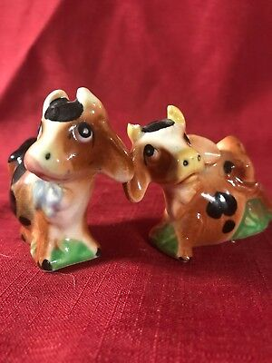 Brown Black Cow Pair Both In Grass Salt And Pepper Shakers