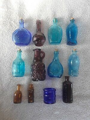 Lot of 12 colored glass bottles