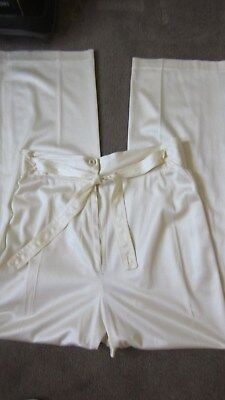 1970,s original cream silky knit flares with tie front.28'waist