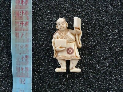 Small Japanese figure Netsuke man with books? signed, Resin? Antique?