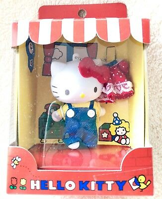 Hello Kitty with a red dress key chain charm