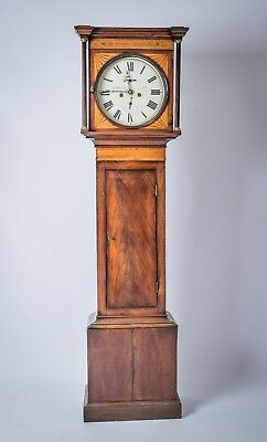The stunning long case standing Grandfather clock