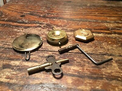 Assorted lot of 5 Antique  Clock Pendulum Bobs And Keys.