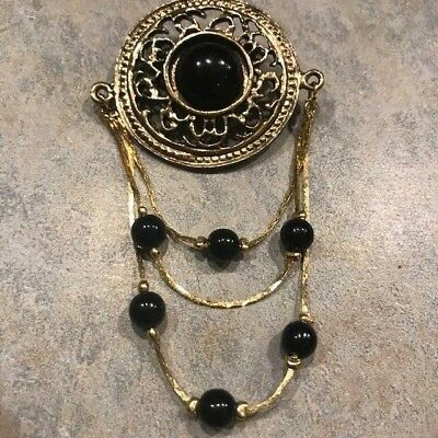 Vintage Gold tone Brooch with black center and 3 stranded dangles with black bea
