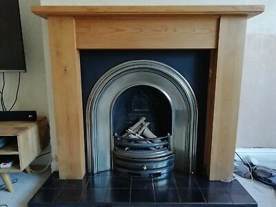 Cast iron fireplace insert. Contemporary/traditional design.