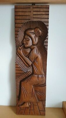 Wooden carving woman pipping possible South American