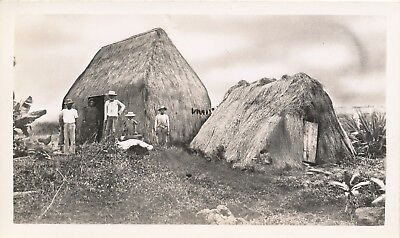 1940s Hawaiian family at old homestead, grass house, Hawaii Photo