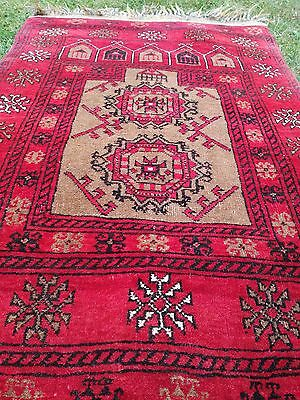 Antique Middle eastern carpet hues of red and gold