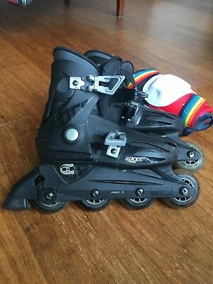 Kid's Roces inline skates, size 4, used, black, with free knee guards