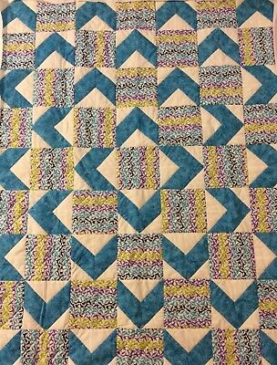 Handmade turquoise and white lap quilt