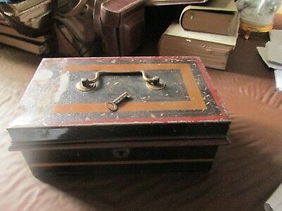 Old metal tin with compartments and a key.