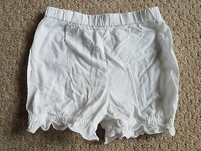 Next 12-18 month white cotton shorts with frill style hem