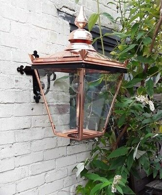 Large copper Lantern in cradle on wall bracket (no 16)