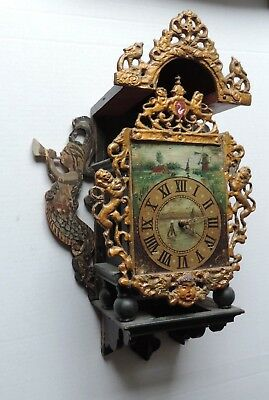 Antique ornate wall clock for parts or repair.
