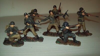 Set of seven factory painted O/P, 21st Century plastic WW2 US Army figures