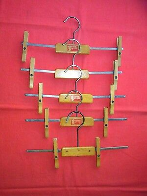 FIVE FOLDING WOODEN CLAMP CLOTHES HANGERS, SKIRTS, TROUSERS. C.B. Ltd LONDON