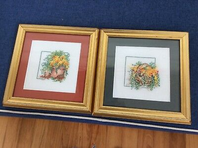 cross stitched framed embroideries