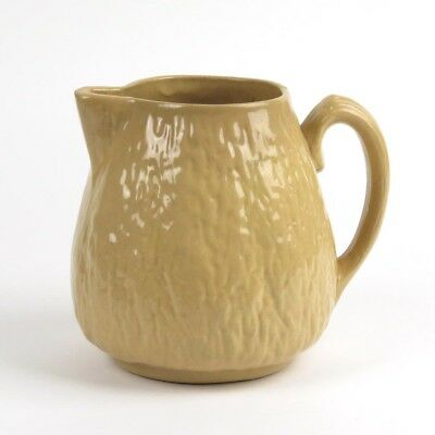 Antique yellow ware pitcher walnut Brush McCoy Pottery
