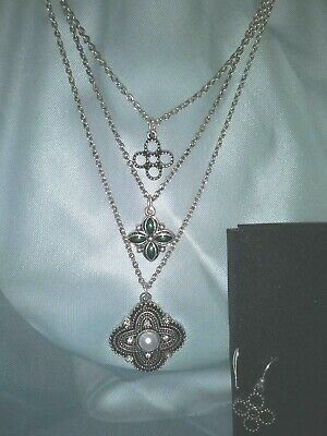 10- Antiqued Charms Tiered Necklace and Earring Gift Set.