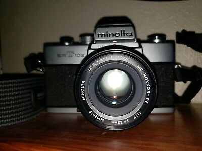 Minolta srt 102 camera and lens with original packaging.