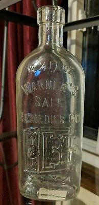 Large PICTURED Warners Safe Remedies Co. Medicine Bottle 9 inches tall 12-1/2 oz