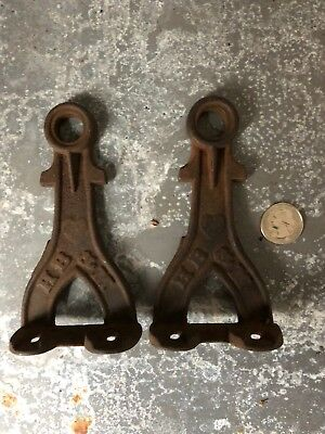 Vintage pair of small cast iron rod/shaft brackets HB & M towel bar