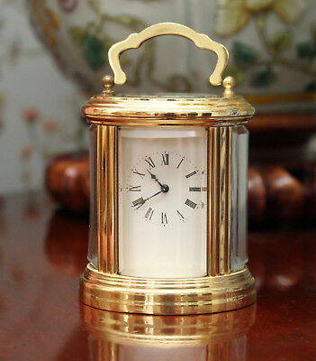 A Delightful Miniature (3 inch) Oval  French Carriage Clock GWO & Key