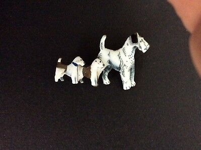 An Enamel fox terrier brooch with two puppies