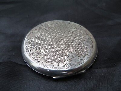 Vintage .900 silver ladies engine turned powder compact, 62 grams total weight.