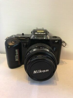 NIKON N4004 with Two Lenses (35-70 mm and 135 mm) and Vintage Mickey Mouse Strap
