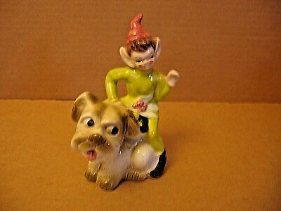 Vintage Ceramic Elf Pixie Figurine riding a Dog