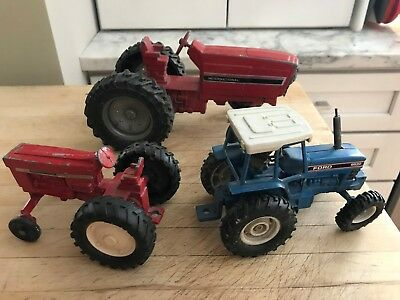Collection of Vintage International/Ford Toy Tractors