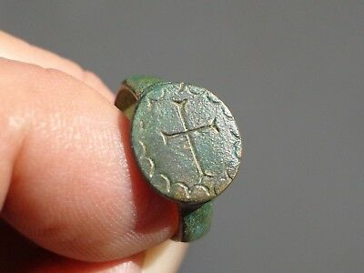 Medieval bronze ring with a cross on the bezel. Circa 9th-12th century AD