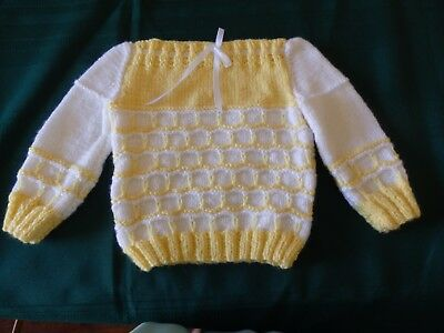 NEW - hand knitted baby Jumper white with yellow pattern.  size 000 to 00
