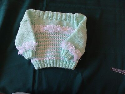 NEW - Hand knitted baby jumper, green with white trim and lace 000