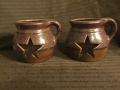 2 Primitive Star Pottery with Cut-Out Star Candle Holder Pitchers